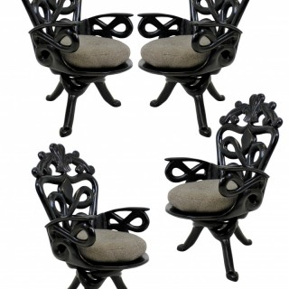 A SET OF FOUR SURREALIST ARMCHAIRS
