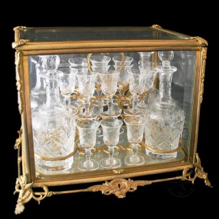 A Fine and Decorative Gilt-Bronze and Cut-Glass Decanter Set by Baccarat