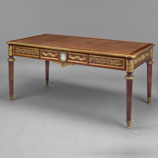 A Louis XVI Style Gilt-Bronze And Jasperware Mounted Mahogany Bureau Plat