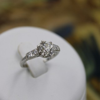 A very fine 1.60ct Old Cut Diamond & Platinum Solitaire Ring with French Cut Shoulders, English, Circa 1930