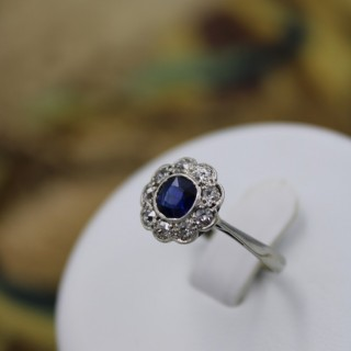 A fine 18 Carat Platinum (Marked)  Sapphire & Diamond Cluster Ring