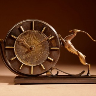 An Art Deco Amsterdam School Patinated Brass/Bronze And Gilded Springbok  Mantel Clock, Circa 1930-40