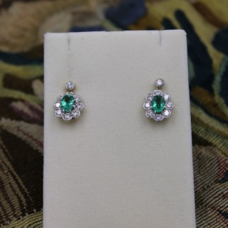 A fine Pair of 18 Ct. White & Yellow gold (stamped) Oval Emerald & Diamond Cluster Drop Earrings, Pre-owned