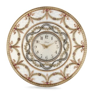 Gold, gemstone, and enamel table clock in the manner of Fabergé