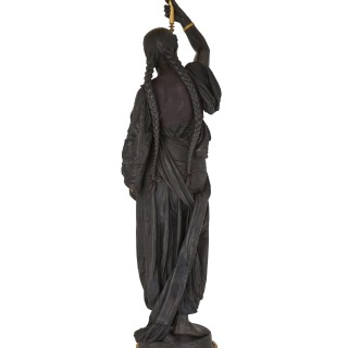 Over life-size bronze sculpture of an Orientalist female figure