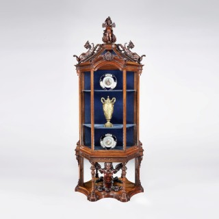 An Italian Carved Walnut Vitrine