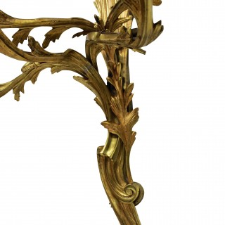 A SET OF THREE LOUIS XV STYLE ORMOLU SCONCES