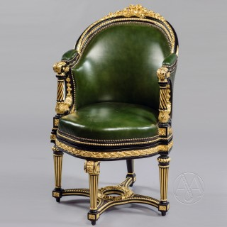 A Louis XVI Style Gilt and Ebonised Carved Rotating Desk Chair Upholstered in Green Leather