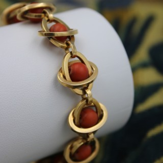 A very unusual 18 Carat Yellow Gold (tested) Coral Bracelet with French Control Marks (worn). Circa 1945