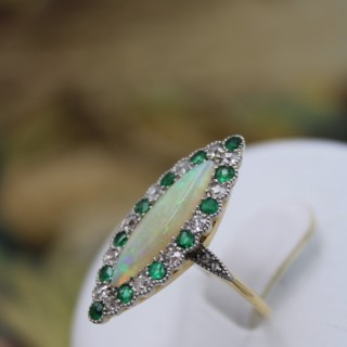 An exquisite 18 Carat Yellow Gold (tested) & Platinum tipped Opal, Emerald & Diamond ring