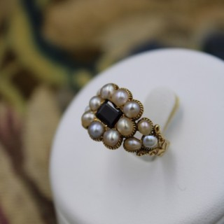 A fine 18 Carat Yellow gold ( worn Marked) Garnet and Natural Pearl Mourning ring Circa 1825