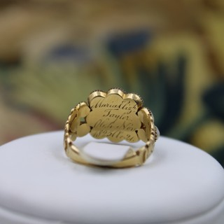 A fine 18 Carat Yellow gold ( worn marks) Garnet and Natural Pearl Mourning ring Circa 1825