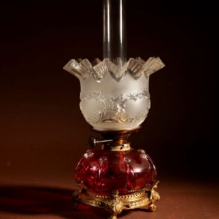 An Unusual Victorian Cranberry Oil Lamp.