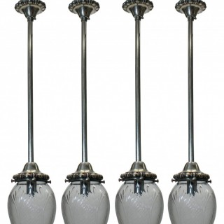 A SET OF FOUR EDWARDIAN PENDANT LIGHTS