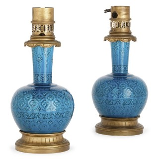 Pair of gilt bronze mounted faience lamps by Deck