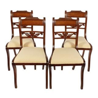 Four Regency Mahogany Sabre Leg Chairs