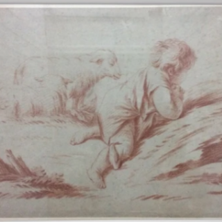 A kneeling child with Lamb