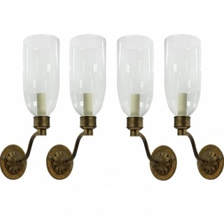 A SET OF FOUR WALL LIGHTS WITH STORM SHADES
