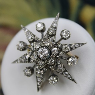 An Exceptional Victorian Diamond Starburst Brooch /Pendant in Silver-Tipped and 10 Carat Yellow Gold (tested), Circa 1880.