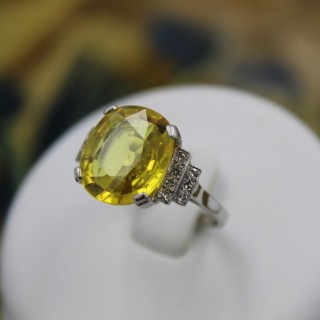 An exceptional Yellow Sapphire and Diamond Ring set in Platinum (Marked), Late 20th Century.