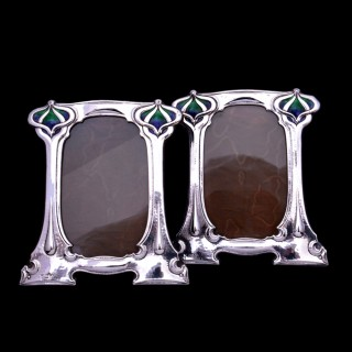 An original pair of silver and enamel photo frames for William Hutton & Sons