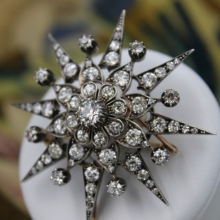 An exquisite Victorian Diamond Starburst Brooch / Pendant / Hair Ornament mounted in 10 Carat Rose Gold & Silver - Tipped, English, Circa 1880.