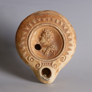 Roman Oil Lamp with Male Figure