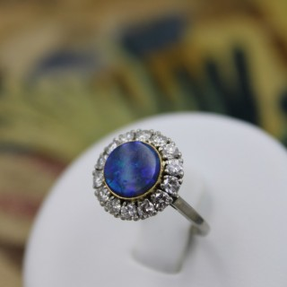 An Exceptional 'Black Opal', Diamond and Platinum (tested) Cluster Ring . Continental Circa 1950