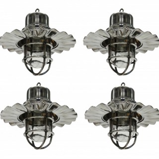 A SET OF FOUR NICKEL SHIP LIGHTS