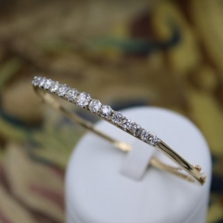 An exceptionally fine Graduated Diamond Bangle mounted in 15ct Yellow Gold (tested), Circa 1890 - 1905.
