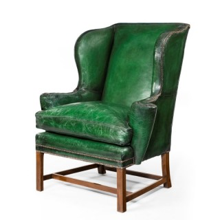 A George I Style Green Leather Wing Arm Chair