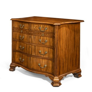 A Striking George III Serpentine Chest Of Drawers