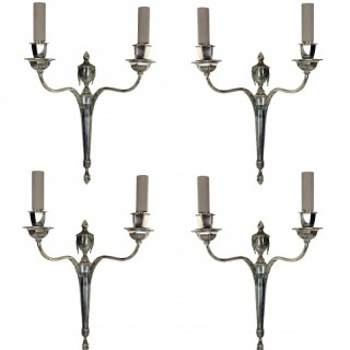 A SET OF FOUR SILVER NEO-CLASSICAL SCONCES