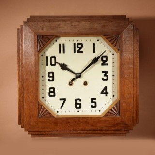 A French Oak Art Deco Wall Clock.