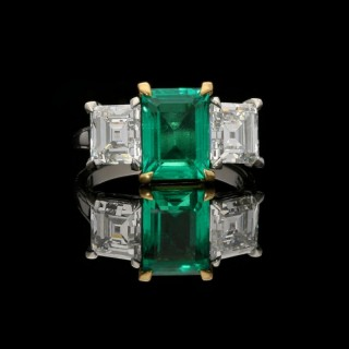 Hancocks Colombian Emerald and Carre cut Diamond Three stone Ring in handmade platinum mount