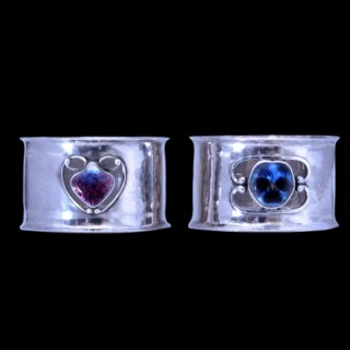 A rare pair of Newlyn School silver and enamel napkin rings