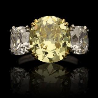 Hancocks 5.13ct Fancy Yellow Cushion and White Diamond Three stone Ring