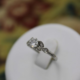 A fine Platinum (marked)  0.45ct Diamond Foliate Solitaire Ring, Circa 1930