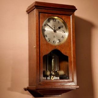 An Early Electrical ATO Haller & Benzing Oak Wall Clock Circa: 1925.