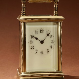 A Decorative French Brass Off White Enamel Dial Carriage Clock. Circa 1900
