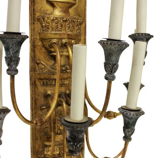 A LARGE PAIR OF GILT METAL EMPIRE STYLE SCONCES