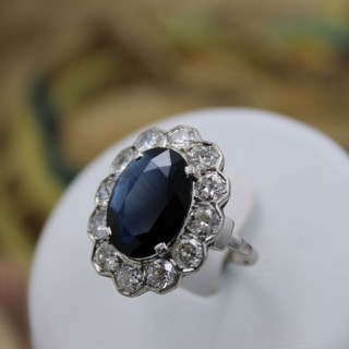 A remarkable Platinum (marked) Oval Sapphire & Diamond Cluster Ring, Circa 1935