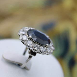 A remarkable Platinum (marked) Oval Sapphire & Diamond French Cluster Ring, Circa 1935