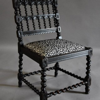 19th century ebonised chair in the style of a 17thc Anglo Indian chair
