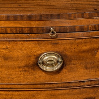 An Elegant and Original George III Period Bow Front Chest