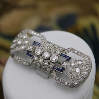 A very fine Platinum, Diamond and Baguette cut Sapphire Brooch, French Circa 1930.