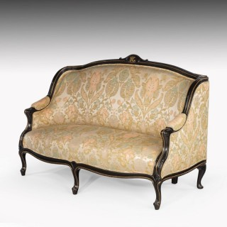 A Fine Mid 19th Century Ebonised Mahogany Sofa