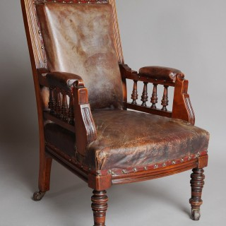 Late 19thc mahogany and leather child's armchair of large proportions