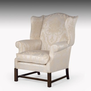A Very Fine and Substantial Pair of Late 20th Century  Mahogany Framed Wing Chairs