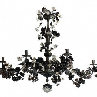 A LARGE BRONZE CHANDELIER DECORATED WITH FLOWERS & LEAVES